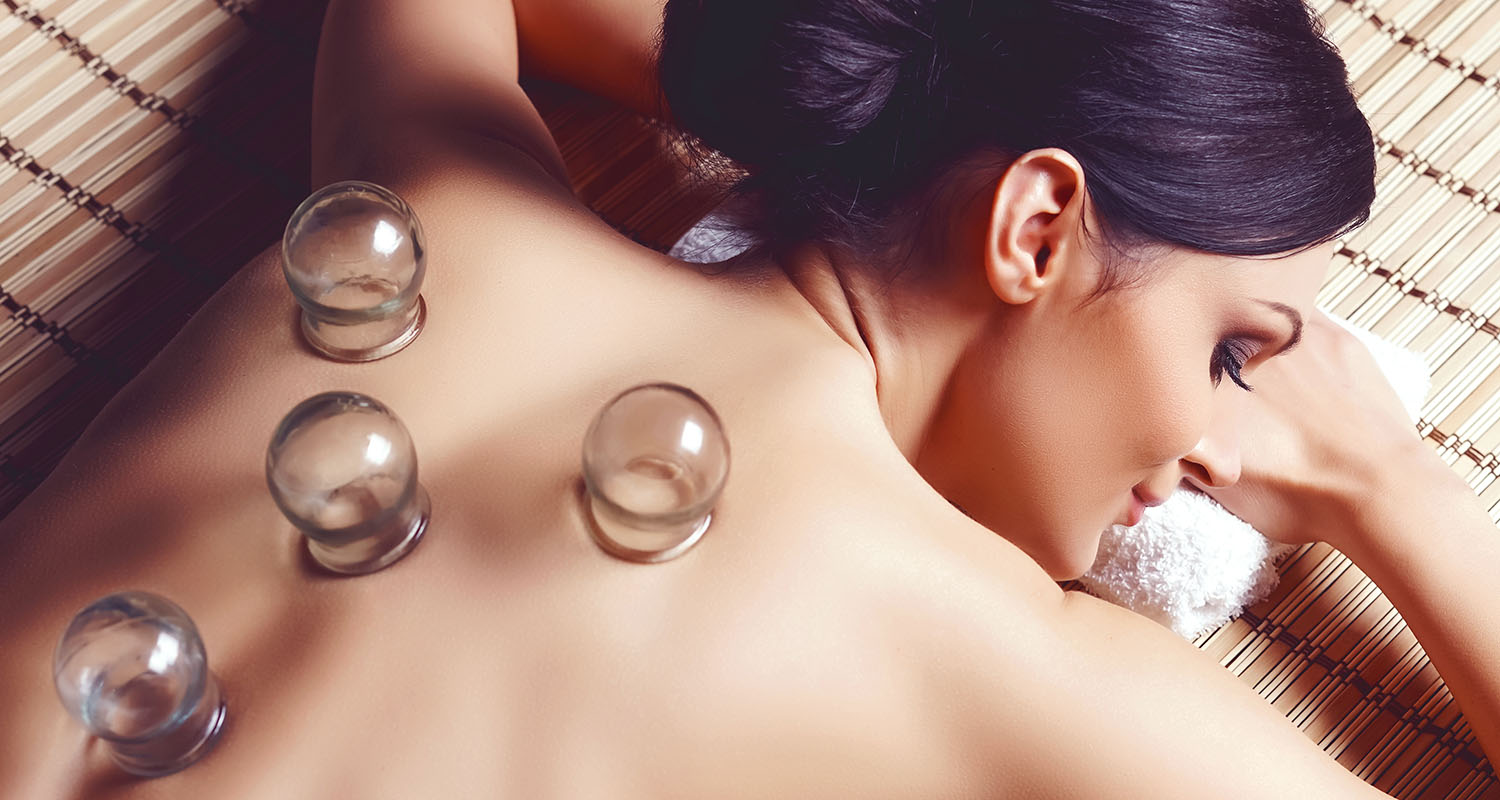 woman enjoying a cupping treatment